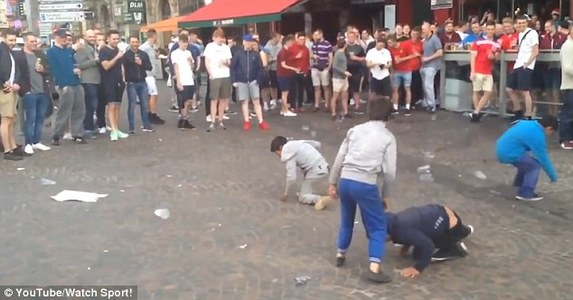 Ban England fans who humiliated begging children