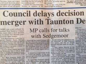 Taunton Deane  delay decision on merger with West Somerset Council until September 2016