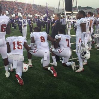 SIGN: Support for University of Nebraska football players taking a knee during the national anthem.
