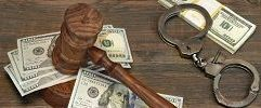 Dollar cash handcuffs and judge gavel on wood table cg9p8308469c th