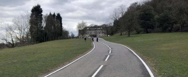 Removing the white road markings in front of Haigh Hall!