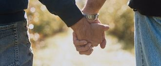 Two men holding hands 812874